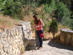 Wife getting water at a water hole on the outskirts of the village in Segovia.